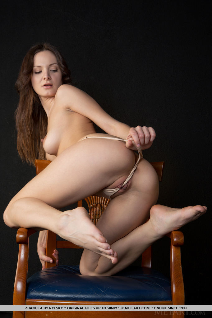 Girl posing naked on chair