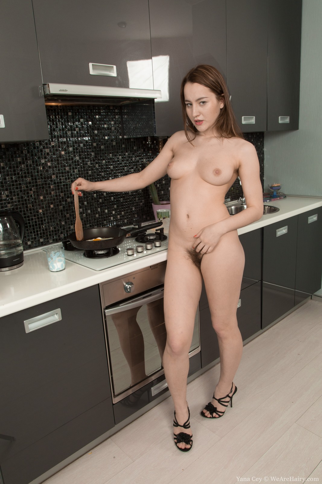 Russian nude girl cooking
